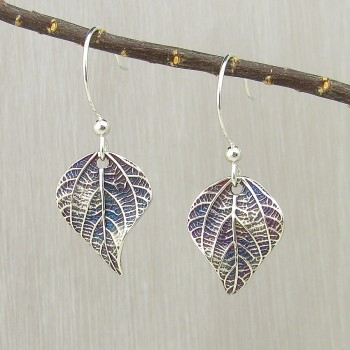 "5/8"" x 7/8"" leaf plus ¾"" earwire The leaves on a green bean plant have an amazing, deep texture, which is captured in these sweet earrings. Earwires are sterling silver in a modern, rounded shape.  Each leaf is Argentium silver, a sterling alloy that is more tarnish-resistant than traditional sterling silver. The shimmering patina brings out the intricate textures of the leaf vein structure.  This leaf is nearly as wide as it is long, which makes it unique amongst my leaf earring designs.  All of my green bean leaf textures were molded from plants growing in my best friend's garden in Honea Path, South Carolina."