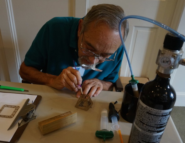 Bill Struve demonstrates a type of 3D printing using BronzClay extruded through a powered syringe. He is building a tiny model of the Eiffel Tower. Very cool!